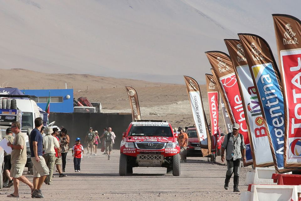 On the brief day of rest, competitors relax and mechanics tend to machines in preparation for the 2nd half of the rally